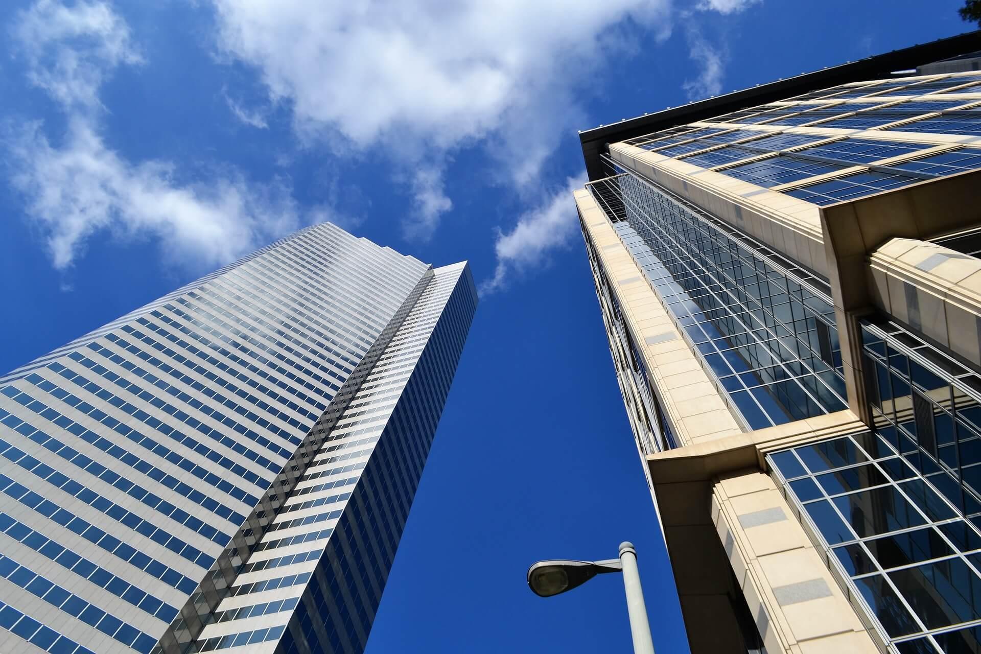 Tall buildings against a blue sky