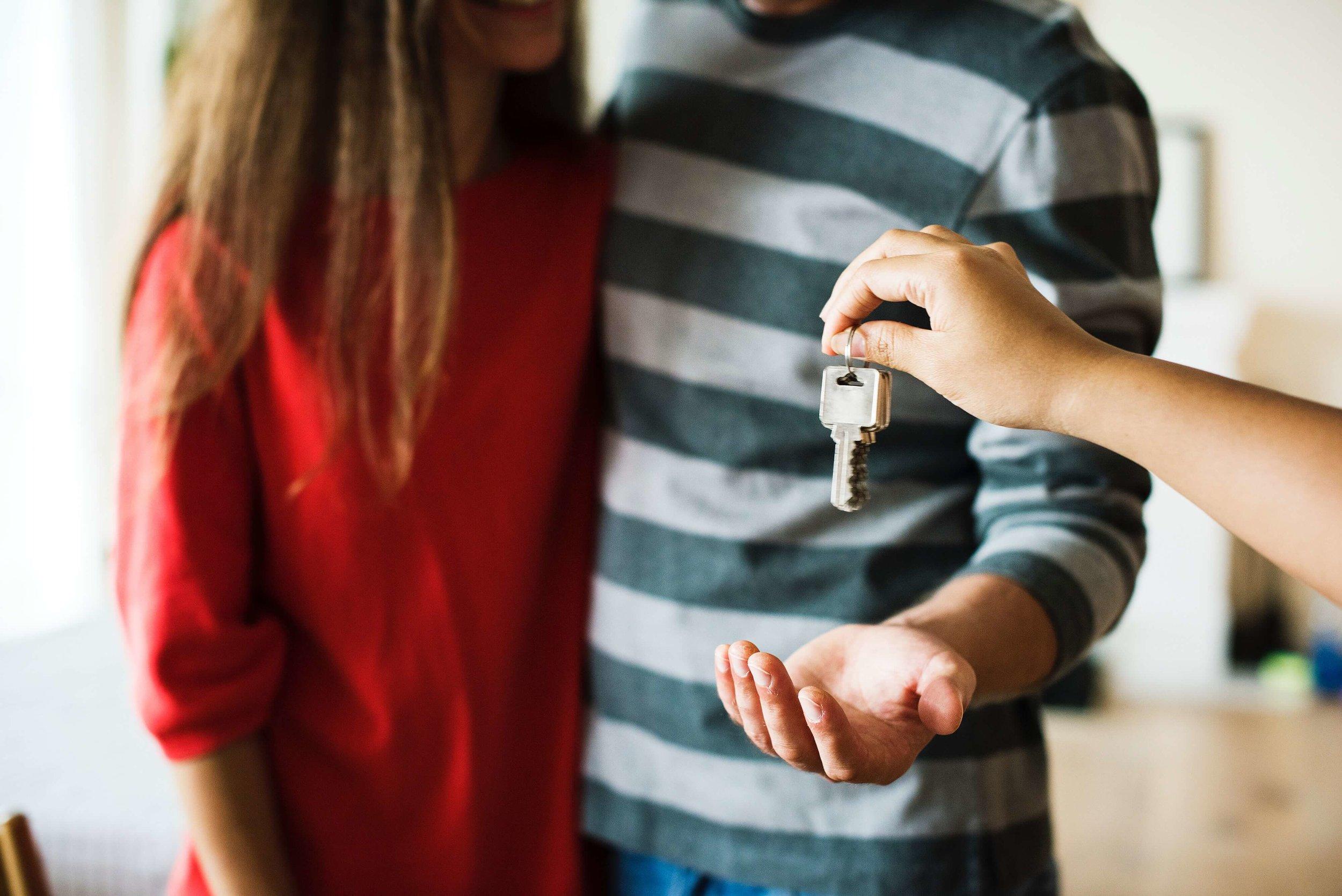 A couple holding keys